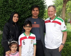 Mac Shelton (right) sporting the Iranian National Soccer Team jersey with new friends in Isfahan.