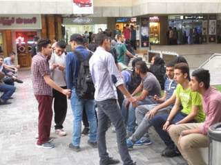 A group of young men hanging out at the City Center.