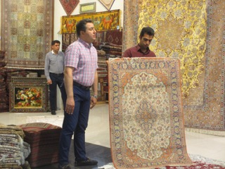 Checking out the local Isfahani rugs.