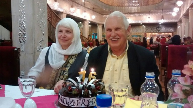 Susan Hansen (left) and Fred Noland (right) smiling in front of the lovely birthday cake that the former students (now friends) provided.