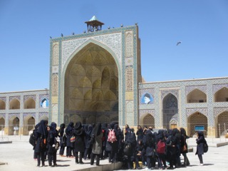 Group of school girls touring Isfahan's famous Imam Mosque.